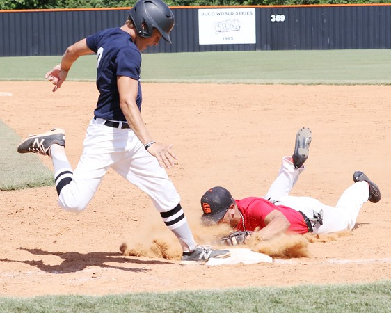 Phoenix special photo by John HaslerOklahoma Navy's Dillon Longbrake beats out an infield single as Oklahoma Red's C.J. Taylor dives for the bag during Sunday's championship game in the 16th Heartland All-Star Classic at Connors State's Perry Keith Park. Navy captured its fifth straight title, winning 5-2.