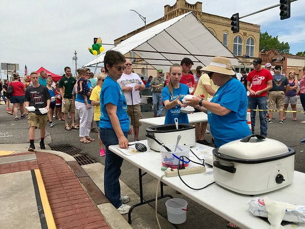Special photo by Travis Sloat<br /> Elizibeth Mayes, Carolyn Stach and Lainey Stach were busy all day Saturday scooping out heaps of savory corn succotash to hungry Corn Festival patrons.