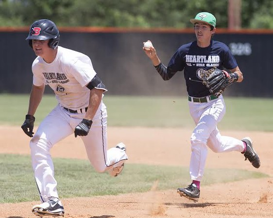 Phoenix special photo by Von Castor<br /> Navy's Blake Hatch chases White's Devin Chancellor back towards first base in a run-down during the championship game of the Heartland Classic at Connors State in Warner. Navy defeated White to claim the title for the sixth straight year.
