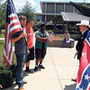 Staff photo by Wendy Burton<br /> Kyle Gibson, left, Jackson Smith, and Kirahn Shoals discuss the symbolism of the Confederate flag with Mason Page, a teenager who arranged a demonstration in front of the Muskogee Civic Center. The two groups debated amicably for a while before agreeing to disagree and parted ways with a handshake.