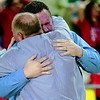 Phoenix file photo by Von Castor<br /> Former Fort Gibson head coach Jerry Walker, right, and assistant Chuck London share an embrace after guiding the Lady Tigers to the Class 4A state basketball title on Saturday in Oklahoma City in 2014. London succeeded Walker as head coach on Monday, pending board approval.