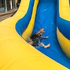 Special photo by Travis Sloat<br /> John Patrick, 5, takes a turn down the water slide Saturday at the ninth annual Fort Gibson Sweet Corn Festival.