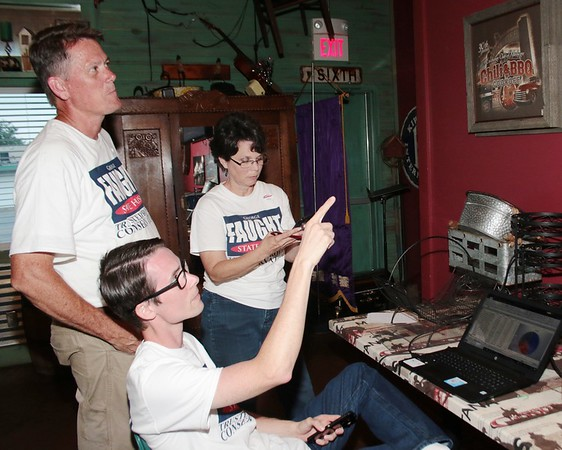JOHN HASLER/Special to the Phoenix<br /> George Faught, left, watches vote count with son, Jamison Faught as wife, Becky Faught, checks numbers.