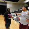 "KENTON BROOKS/Muskogee Phoenix<br /> Muskogee High School graduate Kamara Stancle, left, talks with coach Gena Maxwell prior to start of the Oklahoma Warriors' practice in the Muskogee Civic Center on Wednesday. Stancle, now 42 years old and a 1995 MHS graduate, wanted to play again and ""get back in competition."""