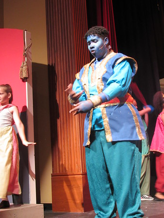 """O'Shea Stevenson portrays the blue Genie in """"Aladdin Jr.,"""" presented by Muskogee Little Theatre's Summer Youth Theater program."""