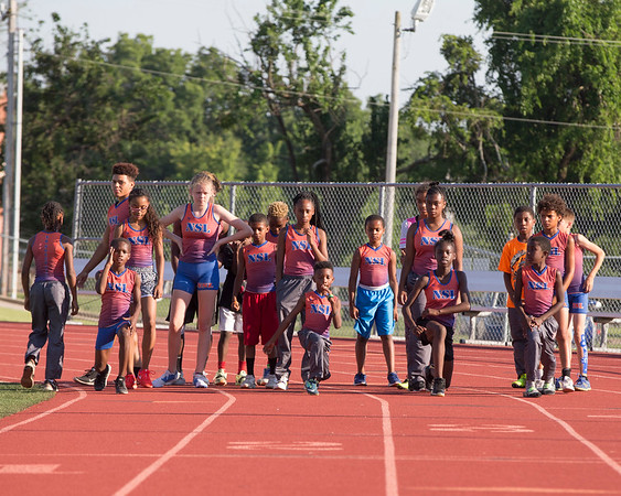 Special photo by Von Castor<br /> Members of the No Speed Limit Track Club begin stretches during a practice Tuesday for regionals in St. Joseph, Missouri.