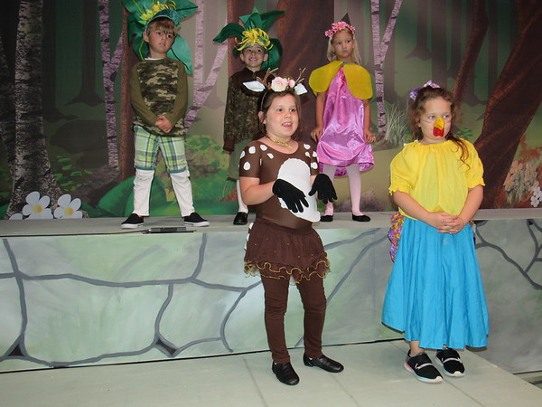 "CATHY SPAULDING/Muskogee Phoenix<br /> Woodland creatures — from left, Jameson Sheldon, Killian Stratton, Allie Goss, Abigail Robison and Embri Watson — await the Shrek's arrival in ""Shrek the Musical Jr."" It is a production of Muskogee Little Theatre's Summer Youth Theater Camp."