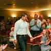Special photo by Mandy Lundy<br /> U.S. Rep. Markwayne Mullin receives applause at his watch party Tuesday at Northeastern State University's Muskogee campus. Mullen beat back a Republican primary opponent to land the party's nomination for another term.