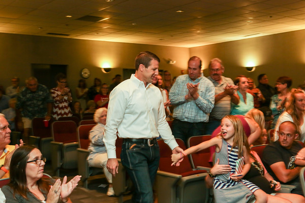 Special photo by Mandy Lundy U.S. Rep. Markwayne Mullin receives applause at his watch party Tuesday at Northeastern State University's Muskogee campus. Mullen beat back a Republican primary opponent to land the party's nomination for another term.