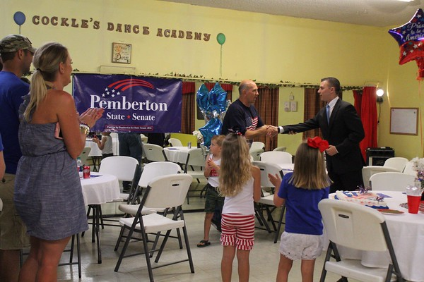 Special photo by Wendy Burton<br /> Dewayne Pemberton, left, receives congratulations from his Republican opponent, John Tyler Hammons, after Tuesday night's unofficial results came in.