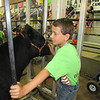 CATHY SPAULDING/Muskogee Phoenix<br /> Hal Higbie, 9, of Princeton, Kansas, pets a cow he's grooming during Be A Champ Show Cattle and Lamb Camp. This is Hal's first year, but an older brother and sister have come before.