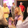 Staff photo by Harrison Grimwood<br /> Muskogee residents gather around Treasure McKenzie at a farewell party for her put on by the Greater Muskogee Area Chamber of Commerce on Thursday at the Oklahoma Music Hall of Fame. McKenzie is leaving the chamber to become the director of Building Bridges for Muskogee's Future at Neighbors Building Neighborhoods. She will be succeeded at the chamber late this month by D.J. Thompson, the chief operations officer of the City of Muskogee Foundation.