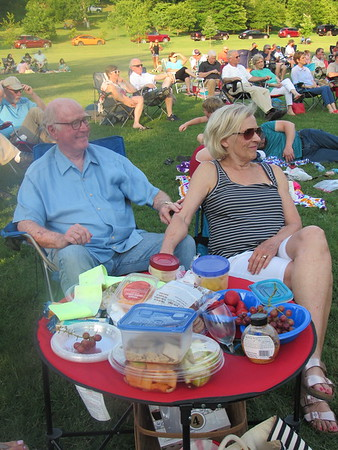 CATHY SPAULDING/ Muskogee Phoenix<br /> Ron and Barbara Wright enjoy a spread of cheese, fruit and wine as they listen to the Muskogee Community Band perform at Symphony in the Park.