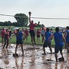 CHESLEY OXENDINE/Special to the Phoenix<br /> Players splash and jump through the mud to try and save the ball during Saturday's Mudstock Volleyball Tournament.