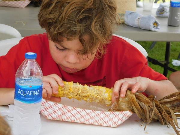 Jacob McCaffery, 11, of Sapulpa, works his way through an ear of corn Saturday at Fort Gibson's Sweet Corn Festival.