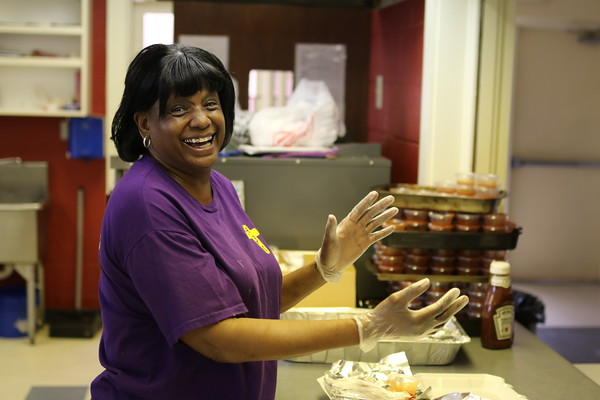 Staff photo by Harrison Grimwood<br /> Ruby Barker prepares fish to fry for a benefit meal Friday at Antioch Baptist Church. The fish fry was a fundraiser for the church's youth ministries.