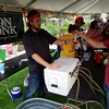"Staff photo by Mark Hughes<br /> Dave Monk provides Brett Thompson one of his brewery's four varieties of beer during Friday evening's second annual Real Okie Craft Beer Fest at the butterfly Papilion at Honor Heights Park. ""This is the best (beer) festival this side of the state,"" said Monk, who is a co-owner of Iron Monk Brewing Co. Around 500 tickets were sold for the event."