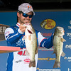Special photo by Von Castor<br /> Skylar Hamilton holds up two of the five bass he weighed in to grab the lead at the Bassmaster Bass Pro Shops Central Open No. 1 on Friday. Hamilton weighed in five fish for a 19 pound, 4 ounce total and leads by 1-4 heading into today's finals.