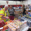 CATHY SPAULDING/Muskogee Phoenix<br /> Volunteer Kyla Martin helps Bonnie Brown find food at the Fort Gibson Emergency Resource Center. Brown said she needed to restock groceries after being without electrical power for three days.