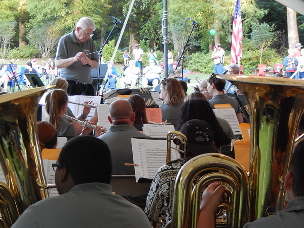 Staff photo by Mark Hughes<br /> Jerry Huffer leads the Muskogee Community Band during its annual Symphony in the Park on Saturday evening on the green at Honor Heights Park. People sitting on blankets and in chairs listened to music from the 1920s through the jazz age, including a salute to Broadway and military veterans.