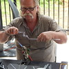 """Staff photo by Mark Hughes<br /> Ron Duncan creates a miniature glass horse Saturday during the Real Okie Plants and Things festival. Duncan said he saw someone creating glass art 10 years ago and he """"fell in love with it."""""""