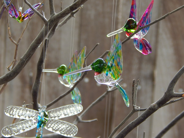 Staff photo by Mark Hughes<br /> Ron Duncan's glass creations includes hummingbirds and butterflies.