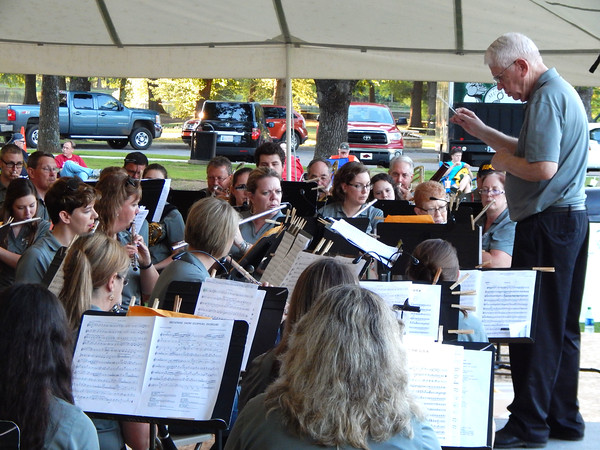 Staff photo by Mark Hughes<br /> The Muskogee Community Band follows the direction of Jerry Huffer for its annual Symphony in the Park performance Saturday at Honor Heights Park.