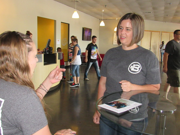 Elizabeth Callahan, right, talks with a visitor to The Brick Church, where Callahan is LifeKids coordinator. She is a native of Fresno, Calif.
