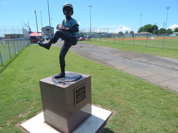 A bronze statute of Bobby Sallie, an 11-year-old Muskogee boy who loved baseball, has been placed at Love-Hatbox Sports Complex in his memory. Bobby was pitching in a game in 1955 on an empty lot on Garland Street when a line drive ball hit him in the temple. He later died from the injury. The statue's dedication takes place at 10 a.m. Tuesday.
