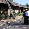 Staff photo by Harrison Grimwood<br /> Muskogee Assistant Fire Chief Stanley Perkins, right, and a firefighter examine the damage from a small fire Monday afternoon at the York Street Professional Center, 1805 N. York St. Perkins said the fire was reported at 5:07 p.m. at the back of the building. Firefighters put out the blaze in about 30 minutes. No one was injured. Most of the damage was contained to an area by an employee entrance. Perkins said fire seeped into the attic and caused some damage there, too, The entire building also sustained smoke damage. Perkins estimated the damage at $100,000. He said the blaze was not suspicious, but a fire marshal will investigate. Muskogee Police Officer James Moore said police blocked off North York Street to let firefighters run a hose across the street.