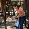 Staff photo by Elizabeth Ridenour<br /> Amy Burgess walks her son, Henry Poss, around the Honor Heights Park playground.