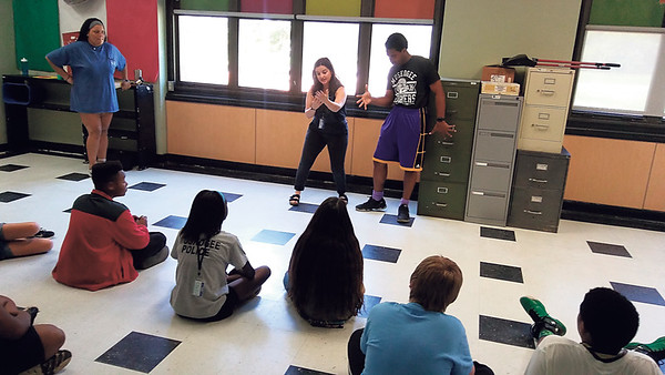 Staff photo by Wendy Burton<br /> Jayden Williams, left, Haley Pierce and John-Pierre LaFleur give a demonstration on performing improv before inviting students to join in at the 21st Century Project Create summer program at Alice Robertson Junior High.