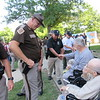 CATHY SPAULDING/ Muskogee Phoenix<br /> Trooper Scott King of the Oklahoma Highway Patrol Marine Enforcement Division at Lake Texoma, left, visits with veteran Raymond Browne on Wednesday. King accompanied Cadet Lawmen participants, who visited Jack C. Montgomery VA Medical Center on Wednesday to thank veterans for their service.