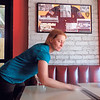 Staff photo by Mike Elswick<br /> Ann Page, one of the partners in Muskogee Brewing Co., works Wednesday on cleaning up for the opening of Station 1 restaurant. While the deli-style eatery is expected to open in the next couple of weeks, she said it will probably be another eight to 12 months before the brew pub portion opens.