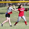 Phoenix special photo by John Hasler<br /> Fort Gibson sophomore Lauren Bergman takes throwing instruction from Nike coach Haley Winter. Nike Softball Camp was held Monday through Thursday at Love-Hatbox Sports Complex for ages 8-18. For more photos go to muskogeephoenix.com/sports.