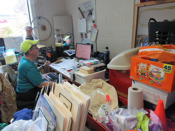 CATHY SPAULDING/Muskogee Phoenix<br /> Flood relief supplies and other items pack into the office where B.J. Charbonneau works at Grace Episcopal Church. The church serves as a Red Cross Shelter.