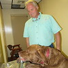 Russell Sain taught his Chesapeake Bay retriever, Sam, to get his own water fountain drinks. Sam even presses the button.
