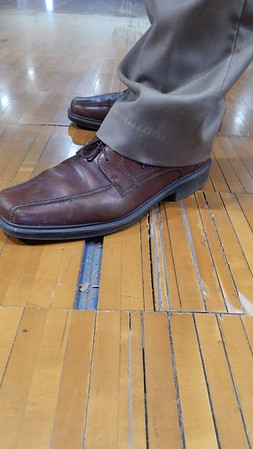 Staff photo by Cathy Spaulding<br /> The wood floor in Porter Schools' Toad Walters Field House has loose and missing strips. A $5.1 million bond issue would help fund a new floor.