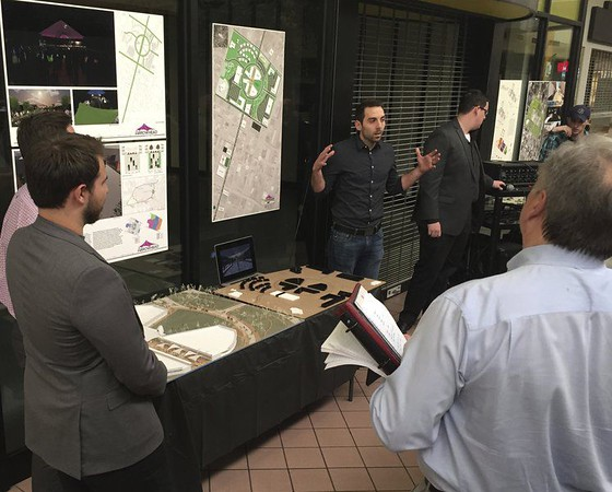 Staff photo by D.E. Smoot<br /> Garrett Slezak, a second-year graduate student who is studying landscape architecture at Oklahoma University in Norman, pitches his team's concept of how Arrowhead Mall might be repurposed as part of the city's downtown revitalization efforts.