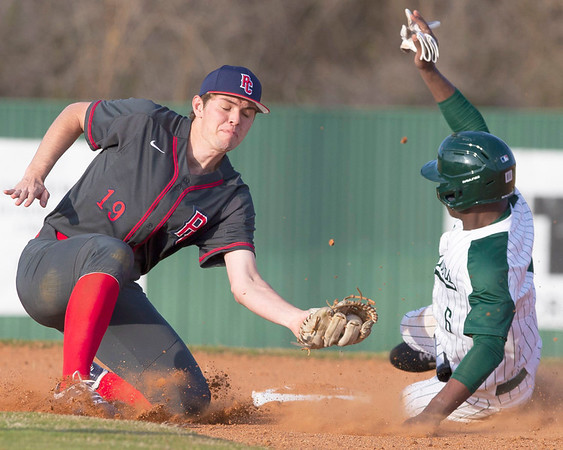 VON CASTOR/Special to the Phoenix<br /> Muskogee's Caleb Webb slides around the tag of the Ponca City shortstop at second base Monday afternoon at Muskogee.