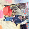 Sophie McGuire of Checotah leads Lilly, her commercial heifer, to drink from a bucket before the heifers show at the Muskogee Regional Junior Livestock Show on Friday at the Hatbox Hangars.