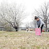 D.E. SMOOT/Muskogee Phoenix<br /> Muskogee County Treasurer Robyn Boswell plants a sign on a county-owned parcel in a northeast Muskogee neighborhood that her office hopes to sell later this month during the first of three sales planned this year for county-owned property.