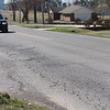 CATHY SPAULDING/Muskogee Phoenix<br /> A driver approaches a rough section of Willey Street. The street, plus a sidewalk along the west side, is a top street project for the town of Fort Gibson.