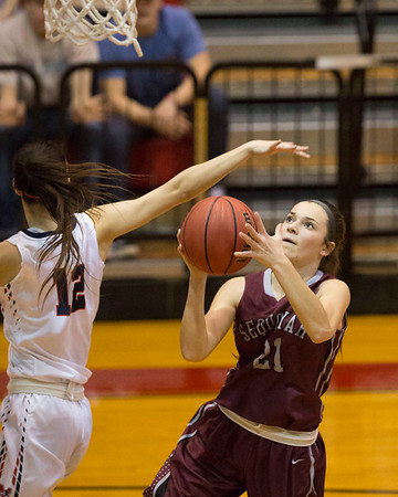 Phoenix special photo by Von Castor<br /> Sequoyah's Aleyxs Keys scores on a layup as Metro Christian's Riley Roth tries to block during Thursday's Class 3A state tournament semifinal in Midwest City.