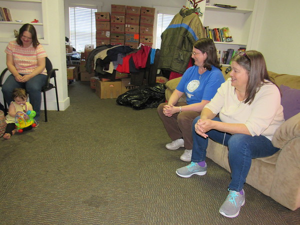 Staff photo by Cathy Spaulding<br /> Freedom Fellowship Church of the Nazarene Pastor Diana Mueller, left, meets with members Sonya Elliott, center, and Judy Johnson. The church meets in what used to be the Girl Scout house.