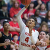 Phoenix special photo by Von Castor<br /> Elgin's Kailah Ballou comes over the back of Fort Gibson's Zoe Shieldnight to foul Alexis Wright late in the fourth quarter Friday in the girls Class 4A semifinal game at Southern Nazarene University in Bethany. The Lady Tigers won 49-43 and play for the state championship at 2:30 p.m. today at State Fair Arena in Oklahoma City.