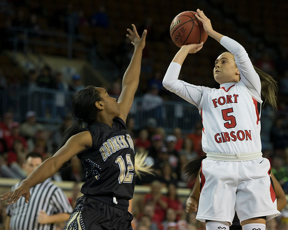 Phoenix special photo by Von Castor<br /> Fort Gibson's Kabree Edgmon shoots over Broken Bow's Corbie King during semifinal action Friday morning at Jim Norick Arena in Oklahoma City.
