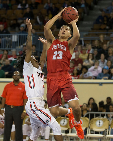 Phoenix special photo by Von Castor<br /> Fort Gibson's Rico Ybarra scores over Tulsa Central's Corey Johnson during the 4A semifinal game Friday night at Jim Norick Arena in Oklahoma City.