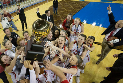 Special photo by Von Castor The Fort Gibson Lady Tigers hoist the gold ball after beating Harrah 55-41 to win the Class 4A state championship on Saturday in Oklahoma City, the fourth for the Lady Tigers.