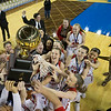 Special photo by Von Castor<br /> The Fort Gibson Lady Tigers hoist the gold ball after beating Harrah 55-41 to win the Class 4A state championship on Saturday in Oklahoma City, the fourth for the Lady Tigers.